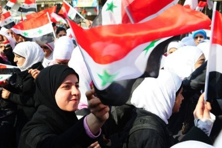 1000s of Syrians hold pro-Assad rallies