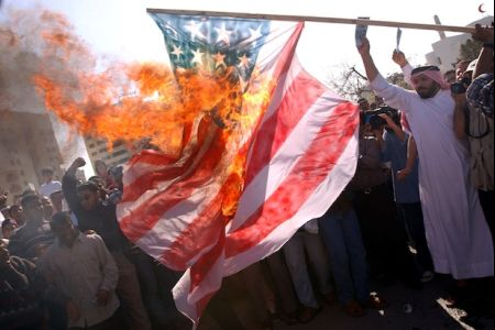 Bahraini protesters torch US flag