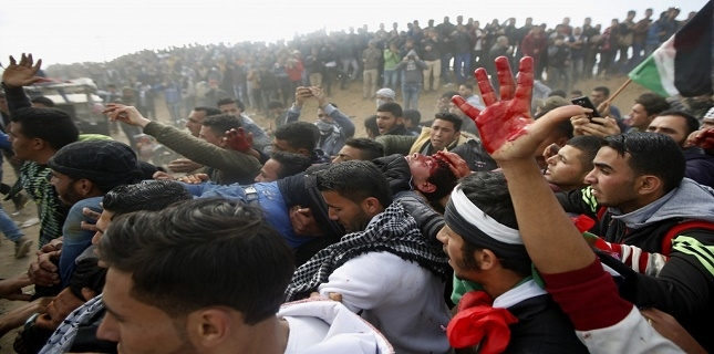 Zionist forces attack Palestinian protesters