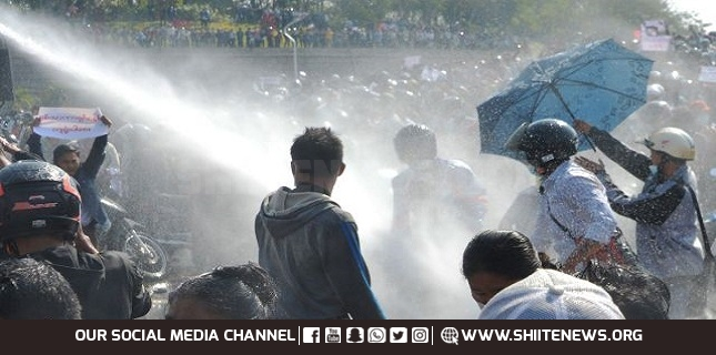 Fears of military crackdown as Myanmar police use water cannon against anti-coup protesters