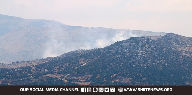 Hezbollah launches rocket fire in response to Israeli air raids