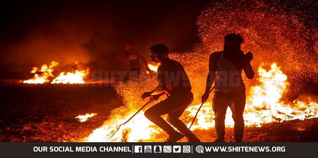Gazans burn tires near fence for second night to protest Israeli siege
